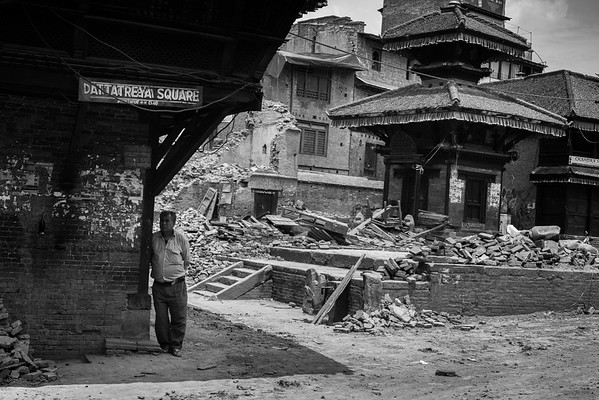A man standing in the remains of a historical square in Bhaktapur.