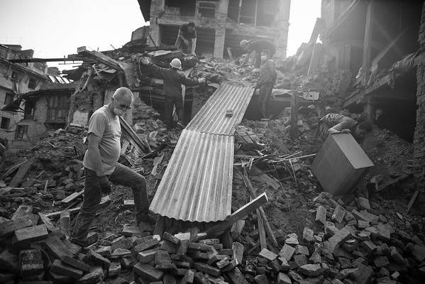 Local residents do what they can to clear the streets from the rubble in Bhaktapur.