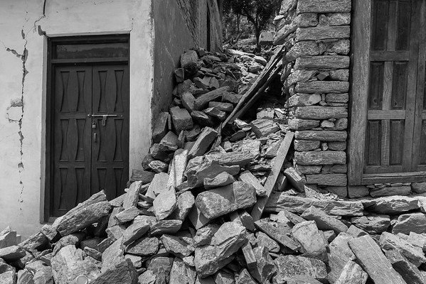 A river of rubble between two houses in a village in Sindhupalchowk area.