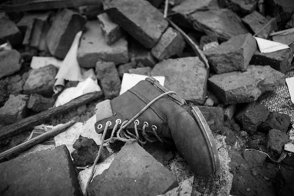 A boot found in the rubble of a destroyed house.