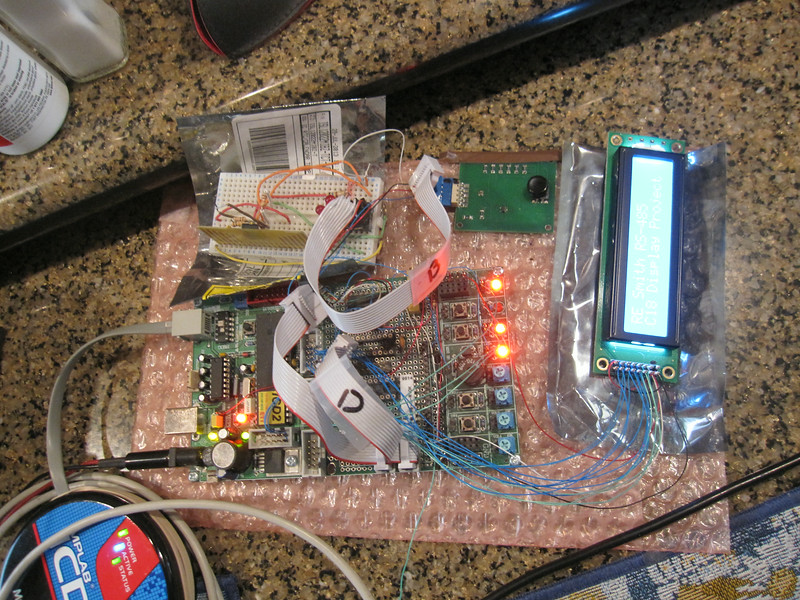 My Futurlec PIC18F4550 development board showing signs of previous projects.  This one wires in the Newhaven NHD-0220DZ-NSW-BBW 2x20 back lit LCD.  I'm migrating the TLCD library from the C30 PIC24 products to C18 PIC18F series chips.  Some memory model issues needed to get resolved.