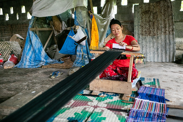 Laxmi Gurung, 28 years old, has been weaving with WSDO for the past three years. She works in the shed right next to her home so she can take care of her child without having to go work at the branch office.