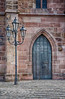 Door at St. Lorenz | This is the side entrance to St. Lorenz Cathedral in Nuremberg Germany.  Built in the 1400's and rebuild after the second world war, St. Lorenz services the Evangelical Lutheran church.