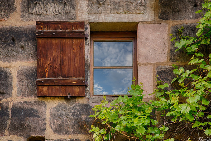 Window in City Wall | This window is in the city wall of Nurenburg, Germany.  Built between the 12th and 16th centuries this wall runs 5 kilometers around the old town.  Imagine the medieval guards looking out this window over the moat onto the fields.