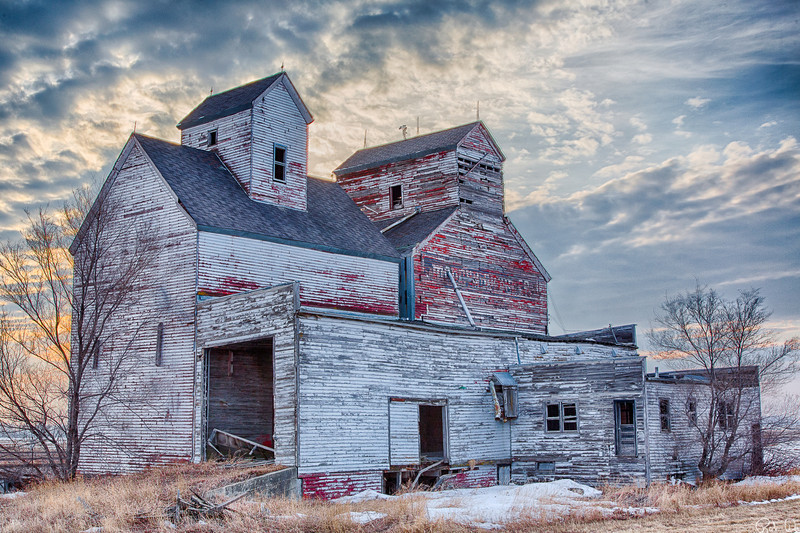 Mondry Grain Company | Abandoned Mondry Grain Company ElevatorThe Mondry Grain elevator is located in the ghost town of Ardoch, North Dakota.  Founded in 1881, <br /> Ardoch was a small town servicing the agricultural needs in the region.  This high dynamic range <br /> photograph depicts the elevator in late winter at sunset.