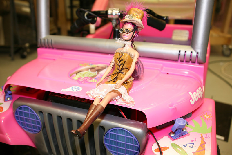 """""""Steampunk"""" Barbie (created by member Don Cross and his wife) readies herself for her Jeep ride."""