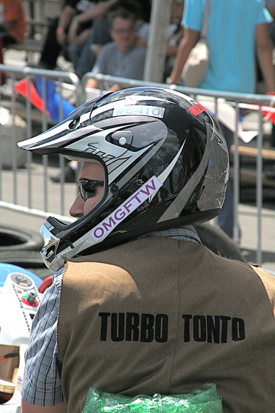 """Kevin Fusselman, sporting a """"Turbo Tonto"""" vest as part of The Lone Hacker theme, readies for Saturday's 20-lap race."""
