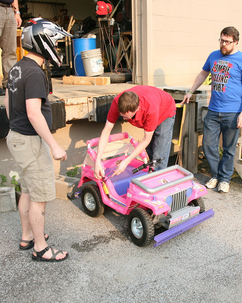 Kevin Fusselman (L) prepares for a test drive while Ben Hutcheson gets the Jeep's electronic controls started.