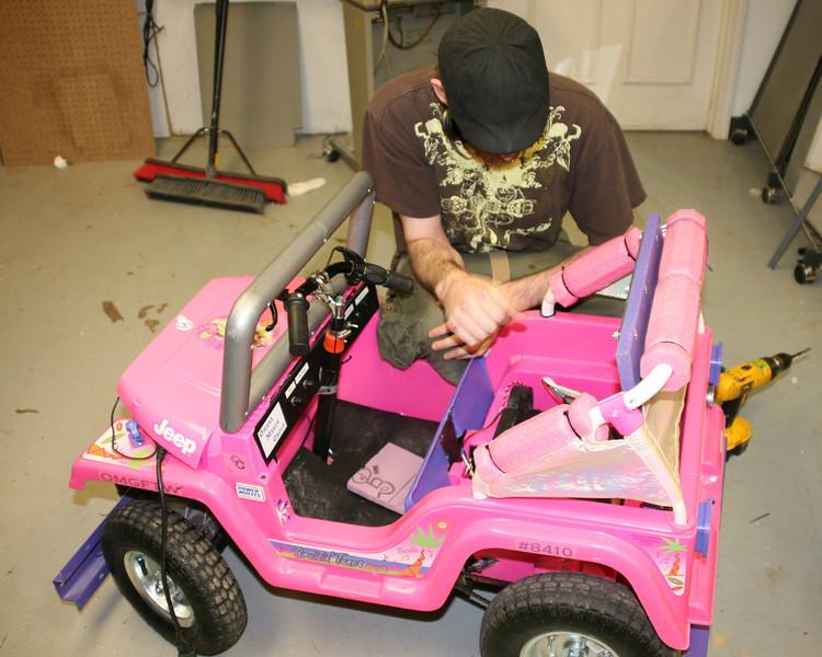 Brandon Norris checks the rear battery compartment.