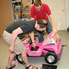 Kevin Fusselman (L) and Ben Hutcheson (R) work on adding a hand brake to the Jeep.