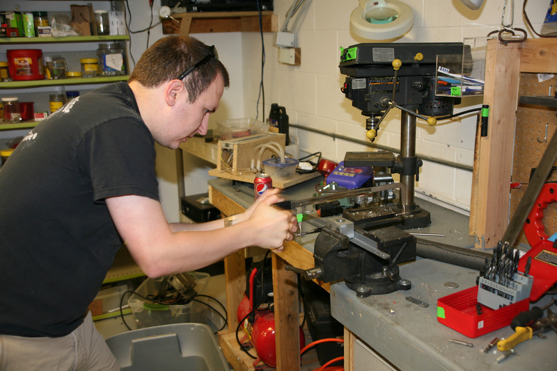 Kevin Fusselman cuts down a bracket for the steering control.