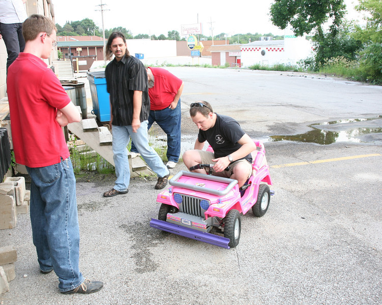 After switching to a single battery, Kevin Fusselman prepares for another test drive while Ben Hutcheson (L) and David Knaack (C) look on.