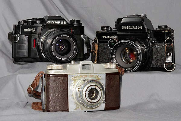 "My three ""besties"".  A Kodak Pony 135 Model C, a Ricoh TLS-401 and an Olympus omPC."