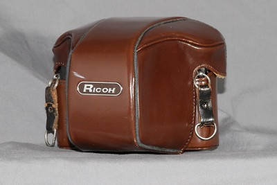 The Ricoh in its leather case.