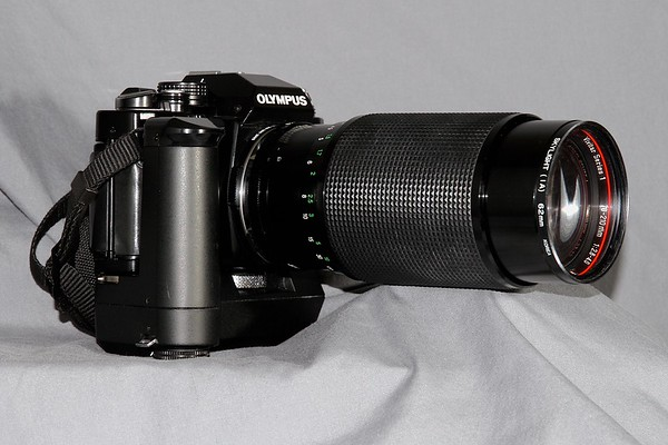 The Olympus with is Telephoto lens and auto winder attached.