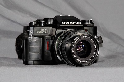 The Olympus om-PC  The PC stood for Program Camera.  Still manual focus.