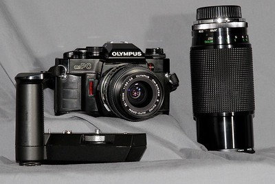 The omPC and its gear.  I have a 3 frame per second auto winder and a Vivitar 70-210 f2.8-4.0 macro zoom.