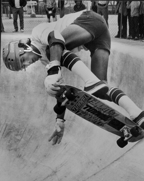 Yeah.  Old school skateboarding.  Tail tapping in a bowl at a skateboard park.