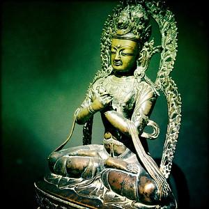 Bronze Buddha in a Green Cove