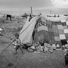 A young boy in front of the tent where he lives in a refugee camp at the Syrian border in Lebanon.<br /> Akkar, Nepal. May 2017<br /> -----------<br /> Un jeune garçon devant la tente où il habite dans un camp de réfugiés à la frontière syrienne au Liban.<br /> Akkar, Liban. Mai2017