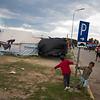 Two young refugees play around a camp set up in a gas station near the Macedonian border in Greece.<br /> Polykastro, Greece. May 2016<br /> -----------<br /> Deux jeunes garçons jouent au milieu d'un camp de réfugiés établi dans une station-service près de la frontière macédonienne en Grèce.<br /> Polykastro, Grèce. Mai 2016