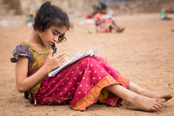 A young student from Kalkeri Sangeet Vidyalaya, music school is hard at work on her year exams on the outside grounds of the school.<br /> Organization: Kalkeri Sangeet Vidyalaya<br /> Dharwad, Karnataka, India. January 2015.<br /> ---------<br /> Une jeune élève remplit son examen final dans la cour extérieur de l'école de musique Kalkeri Sangeet Vidyalaya.<br /> Organisme: Kalkeri Sangeet Vidyalaya<br /> Dharwad, Karnataka, Inde. Janvier 2015.