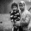 A father carries his daughter inside Moria refugee camp under pouring rain.<br /> Lesvos Island, Greece. October 2015.<br /> -----------<br /> Un père porte sa fille à l'intérieur du camp de réfugiés de Moria sous une pluie torrentielle.<br /> Ile de Lesbos, Grèce. Octobre 2015.
