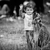 A young refugee boy stops on way to the transit camp of Gevgelija to smile and wave at the photographer.<br /> Gevgelija, Macedonia. October 2015.<br /> -----------<br /> Un jeune garçon réfugié s'arrête sur le chemin du camp  de transit de Gevgelija pour saluer et sourire au photographe.<br /> Gevgelija, Macédoine. Octobre 2015.