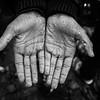 A young refugee boy shows his hands after being outside in the pouring rain for two days in Moria refugee camp.<br /> Lesvos Island, Greece. October 2015.<br /> -----------<br /> Un jeune réfugié montre l'état de ses mains après être resté deux jours à l'extérieur sous la pluie dans le camp de réfugiés de Moria.<br /> Ile de Lesbos, Grèce. Octobre 2015.