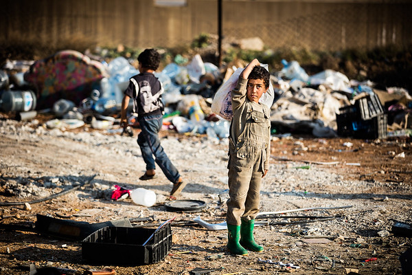 Children working in a scrapyard to earn enough money for their families living in refugee camps at the Syrian border.<br /> Bekaa Valley, Lebanon. November 2015.<br /> -----------<br /> Des enfants travaillent dans une cours à feraille pour subvenir aux besoins de leur famille vivant dans un camp de réfugié à la frontière syrienne.<br /> Vallée de la Bekaa, Liban. Novembre 2015.
