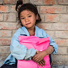 A young girl clutching her new school uniform and supplies she just received at her school in a little village high in the Himalayas. <br /> Organisation: Nepalaya Foundation<br /> Gorkha, Nepal. March 2017<br /> -----------<br /> Une jeune fille tient fermement son nouvel uniforme et fournitures scolaires qu'elle vient de recevoir dans son village des montagnes himalayennes.<br /> Organisme: Nepalaya Foundation<br /> Gorkha, Népal. Mars 2017