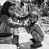 A mother washes her son in their rural village receiving the support of EDUcare programs<br /> Organization: EDUcare<br /> Punjab, India. March 2015.<br /> ---------<br /> Une mère lave son enfant dans un village d'une région rurale supporté par les programmes de l'organisme EDUcare.<br /> Organisme: EDUcare<br /> Punjab, Inde. Mars2015.