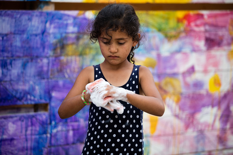 A young girl washing her hands in Kara Tepe refugee camp, considered to be the camp with the highest standards of living conditions in Europe.<br /> Kara Teperefugee camp, Lesvos Island , Greece. May 2016<br /> -----------<br /> Une jeune fille se lave les mains dans le camp de Kara Tepe, considéré comme le camp avec les meilleures conditions de vie en Europe.<br /> Kara Tepe, ile de Lesbos, Grèce. Mai 2016