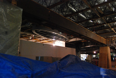 Looking from the far corner of the program/community room. The speaker/presenter will be beneath the oval shape ceiling structure.