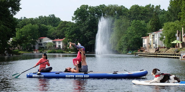 Acro yoga on paddle board