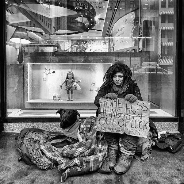 This is what America has come to in 2012. A homeless American  girl begging for change outside a branch of American Girl a shop / web business that promotes confidence etc in young girls. Thats the juxtaposition that is NYC and the USA. Though this is not confined to any one country its just very apparent in some Cities