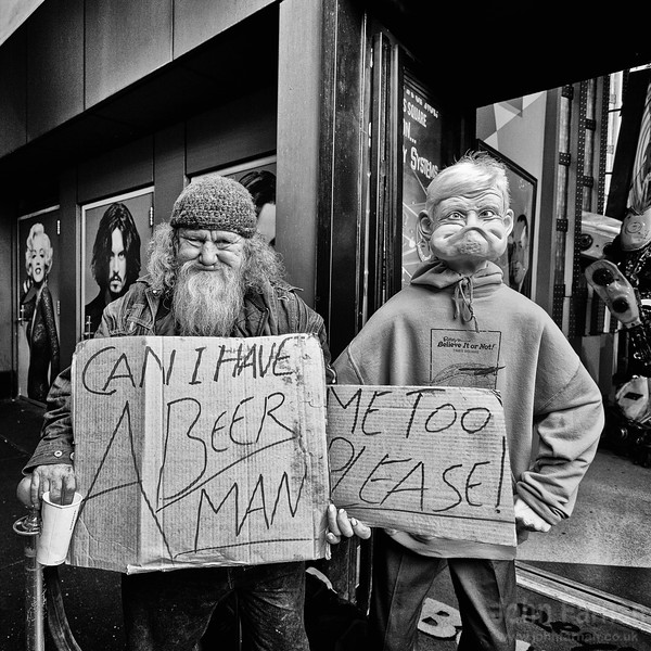 """Slightly comical but another side to the homelessness issue in NYC. This guy to give him credit was well known at the Ripleys Believe it or not attraction. Posing as if an actual part of the attraction. He had hooked up with the model to the right and had a card for """"him"""" as well. Very clever and very enterprising."""
