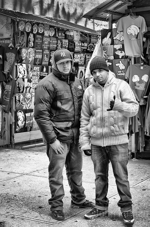 A couple of guys Two guys working on a stall somewhere in lower Manhattan