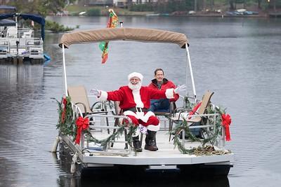 Santa arrives at Lake Anne Plaza by boat