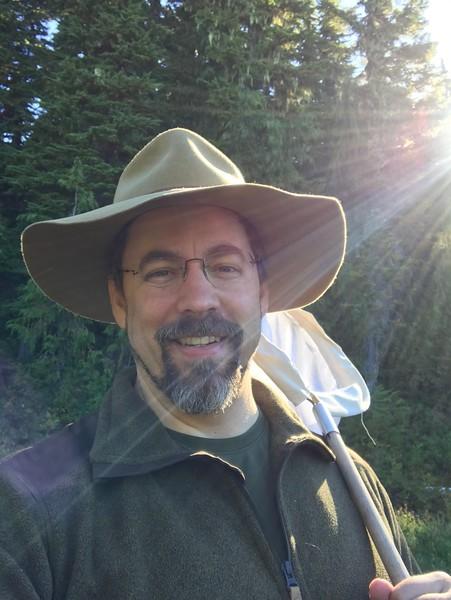 Volunteer Bors Vesterby wields a butterfly net PC: Bors Vesterby