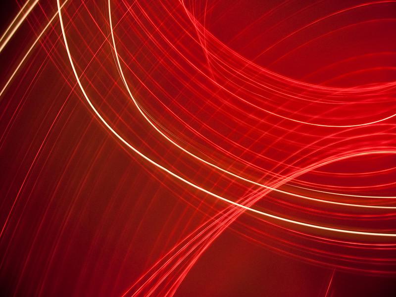 089 - Camera Tossing<br /> ----------------------------<br /> Premiers essais pour cette technique que je découvre. Cela consiste à lancer (!!!) l'appareil photo devant une source lumineuse en pause longue. Il faut choisir des lumières petites et vives et surtout prévoir de quoi amortir la chute de l'appareil au cas ou on le rattrape pas ;-) Ici fait devant une guirlande lumineuse rouge et quelques bougies.<br /> <br /> First try for this new technique for me that consists in throwing the camera behind little lights while in long exposure. Just be careful to catch the camera when it falls and place foams for security ;)