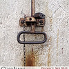 Project 365: March 28 - Rusty Pull. A rusty pull and lock from an old silo in an abandoned railway building.