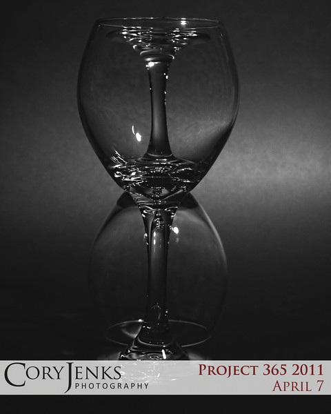 Project 365: April 7 - Hour Glasses. Simple black and white still life photo. Two wine glasses looking as one hourglass.