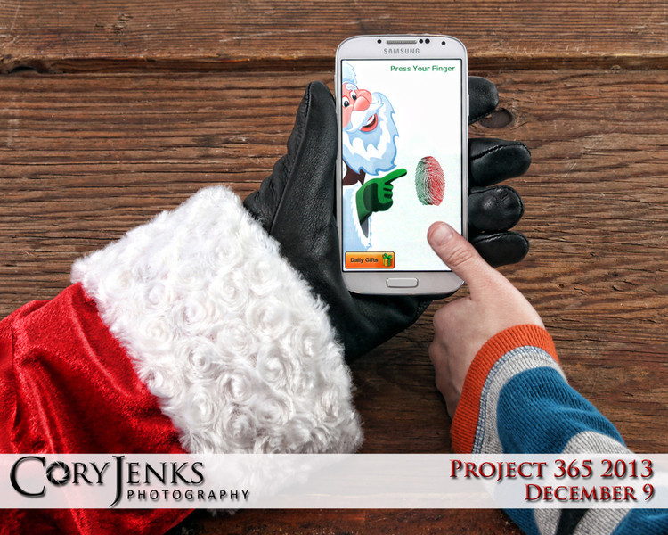 "Project 365: December 9 - Santa's Helping Hand #8. This is the eighth in a series called Santa's Helping Hand.  Santa tries his new ""naughty or nice"" App on his new smart phone."