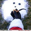 Project 365: December 15 - Santa's Helping Hand #14. This is the fourteenth in a series called Santa's Helping Hand.<br /> <br /> Santa helps an old dear friend by holding onto his corn-cob pipe, button nose, and two eyes made out of coal until the next snow.