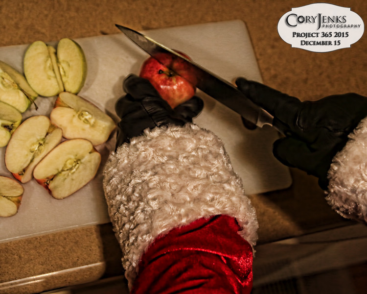 Project 365: December 15 - Santa's Helping Hand 15.<br /> <br /> Santa helps cut apples for the reindeer's snack time.