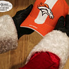 Project 365: December 13 - Santa's Helping Hand 13.<br /> <br /> Santa takes off his traditional red and white hat and dons his favorite team's hat to help cheer on the Broncos.