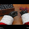Project 365: December 8 - Santa's Helping Hand #8.<br /> <br /> Santa takes on the unfortunate task of preparing chunks of coal for all the naughty boys and girls. Santa does not allow the elves to help with this activity; elves are at their best when they working with positive Christmas energy.