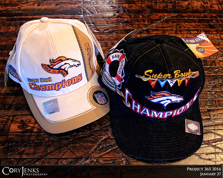 Project 365: January 27 - New Hat. Eighteen years ago this week the Broncos won their first of back to back Super Bowls. One commemorative hat has to be one of the ugliest hats ever and the other is one of the best looking but both are awesome! Time to add a third to the collection.