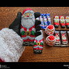 Project 365: December 9 - Santa's Helping Hand #9.<br /> <br /> Santa helps review the 2016 licensing products. All proceeds for the use of Santa's image go to charity, that's just the kind of guy Santa is.